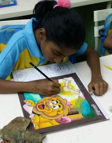 Student having their visual art class.
